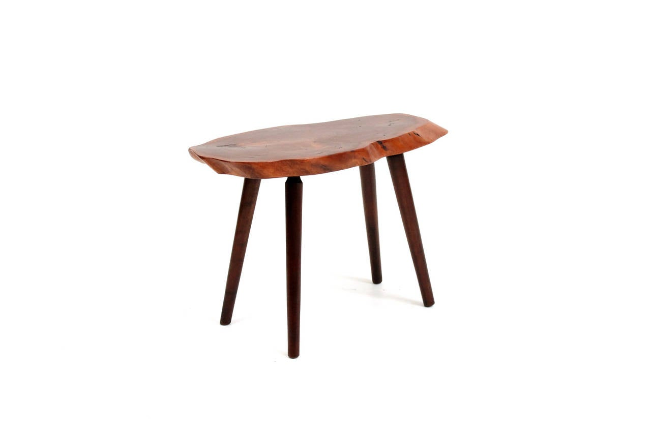 Studio made end or side table by Vermont artist and furniture maker Roy Sheldon. Sheldon would source the tops for his tables from his extensive property and sell them from his front yard. As his label indicates, this table is made from