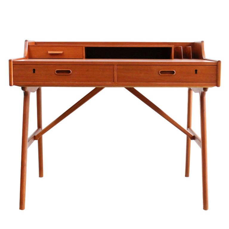 teak writing desk Danish modern peter lovig nielsen style teak desk - this writing desk is featured in a solid wood with a glossy teak finish this danish modern style workstation has 6 spacious drawers, dovetailed joinery and sleek tapered legs.