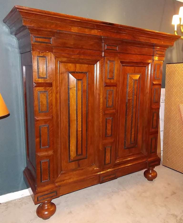 Dutch Baroque Kas or armoire with applied trim, nicely paneled and raised on bold turned feet. Beautifully conserved and polished.