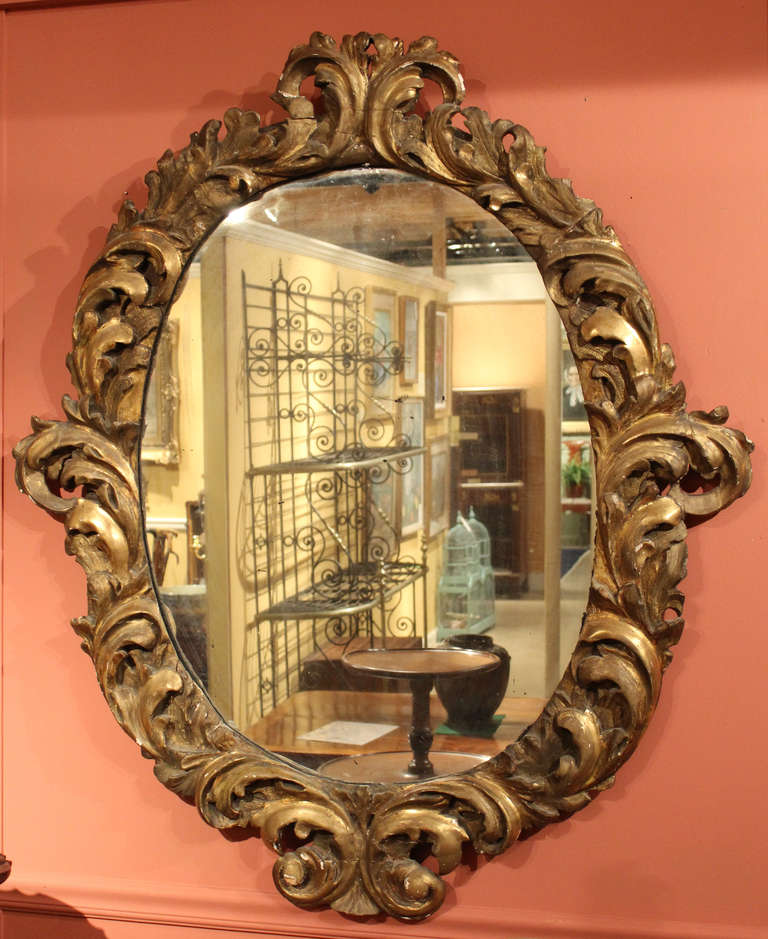 Large 18th century italian baroque oval gilt wood mirror for Baroque mirror