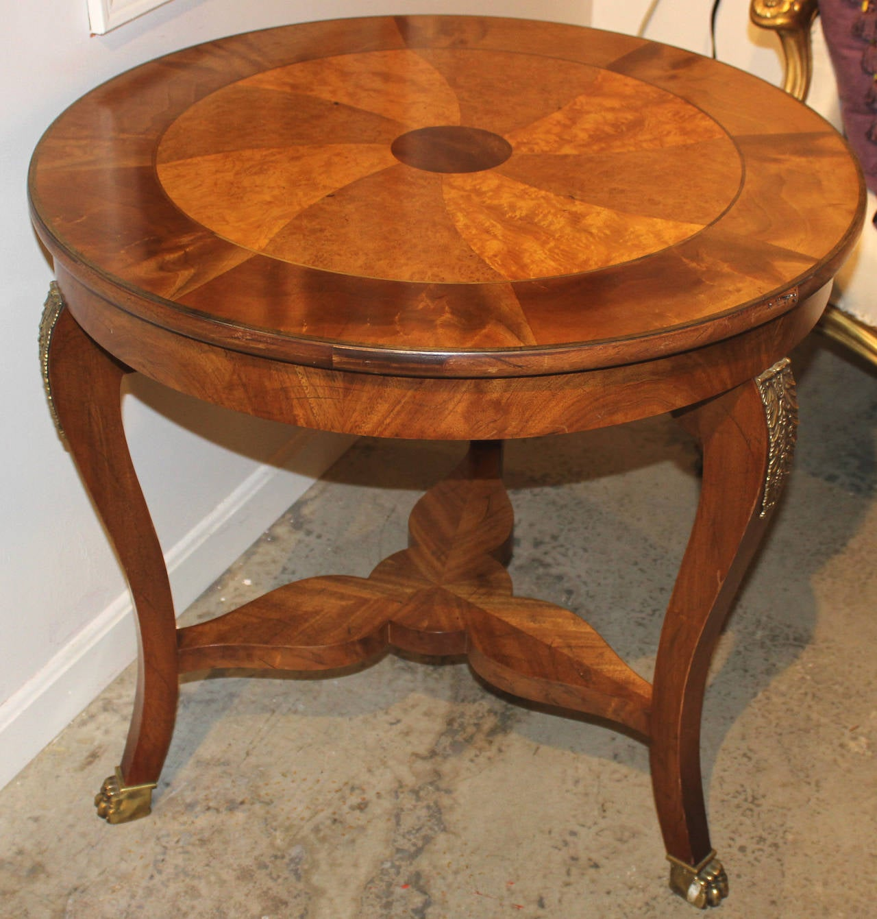 baker furniture fruitwood and mahogany center table with pinwheel