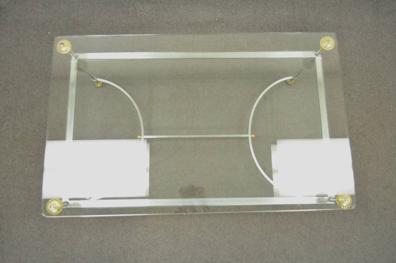 Rare Brass, Brushed Steel, and Glass Claw Foot Coffee Table after Maison Jansen For Sale 2
