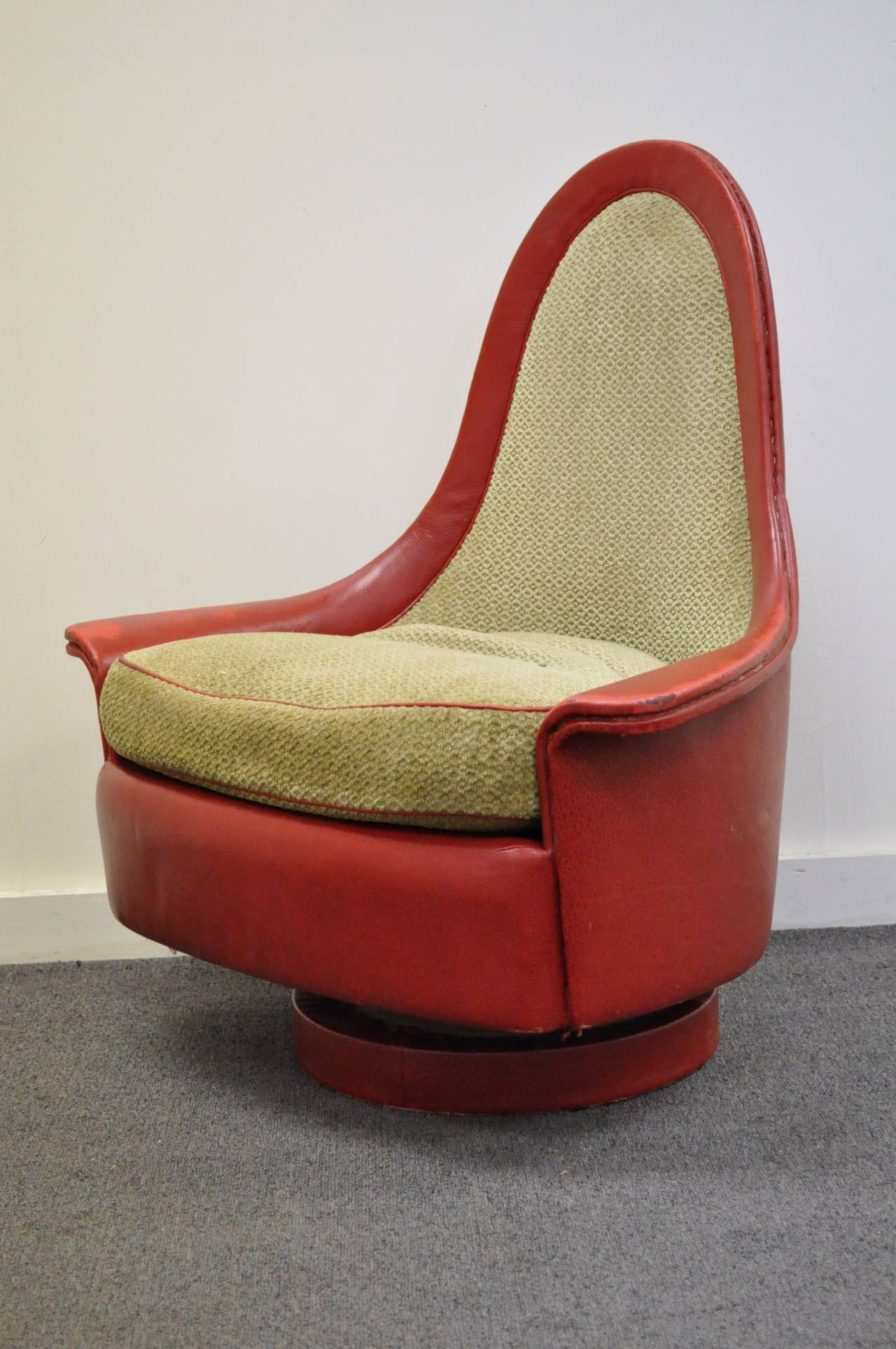 Very rare original, mid century modern swivel and tilt petite armchair attributed to Milo Baughman for Thayer Coggin. This unique item features a sculpted frame with rolled and flared arms, tapered tear drop back, revolve and tilt plinth, and