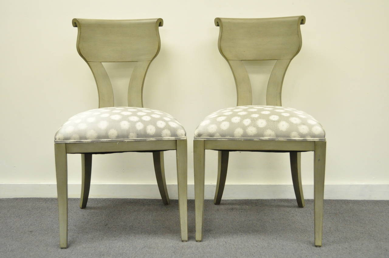 Very nice pair of  Vintage Neoclassical / Hollywood Regency Style Klismos Side Chairs with a Greenish Gray Wash Painted Finish. The set features scrolled shapely backs and remarkable clean lines to the frames.
