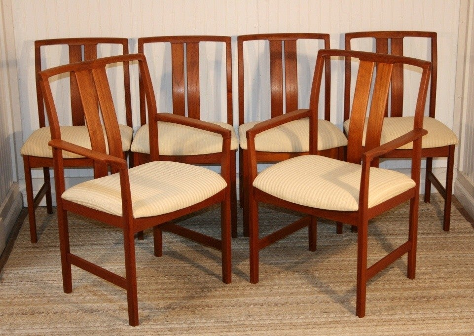 this set of 6 teak danish modern slat back dining room chairs is no