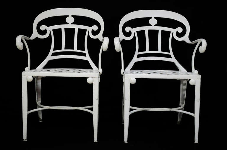 Set of 14 neoclassical style cast aluminum garden armchairs from the world famous Tavern on the Green Restaurant (1934-2009) in Central Park, NYC which was located on the upper west side of Manhattan. These remarkable chairs feature spade form back