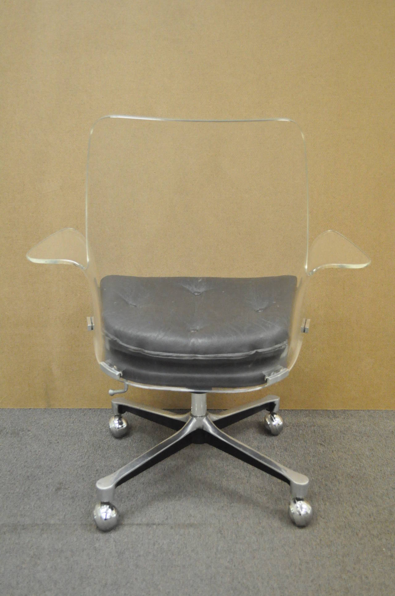 American 1960s sculpted lucite swivel desk chair after vladimir kagan and estelle laverne for sale