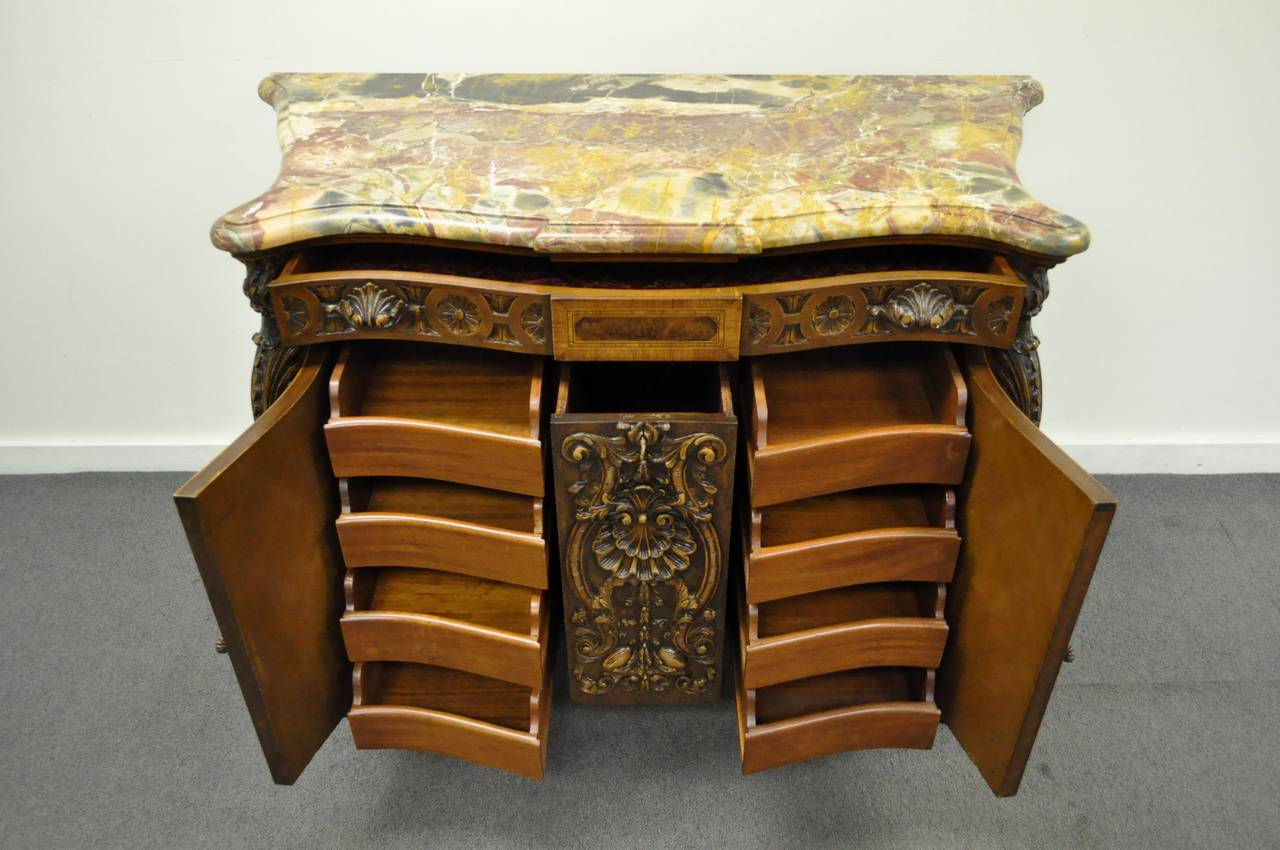 Remarkable French, Early 20th Century, Custom Quality Rogue Marble Top Walnut Commode in the Louis XV / Baroque Style. This stunning item features expert carvings throughout including the large center drawer, shapely legs, and upper drawer pulls.
