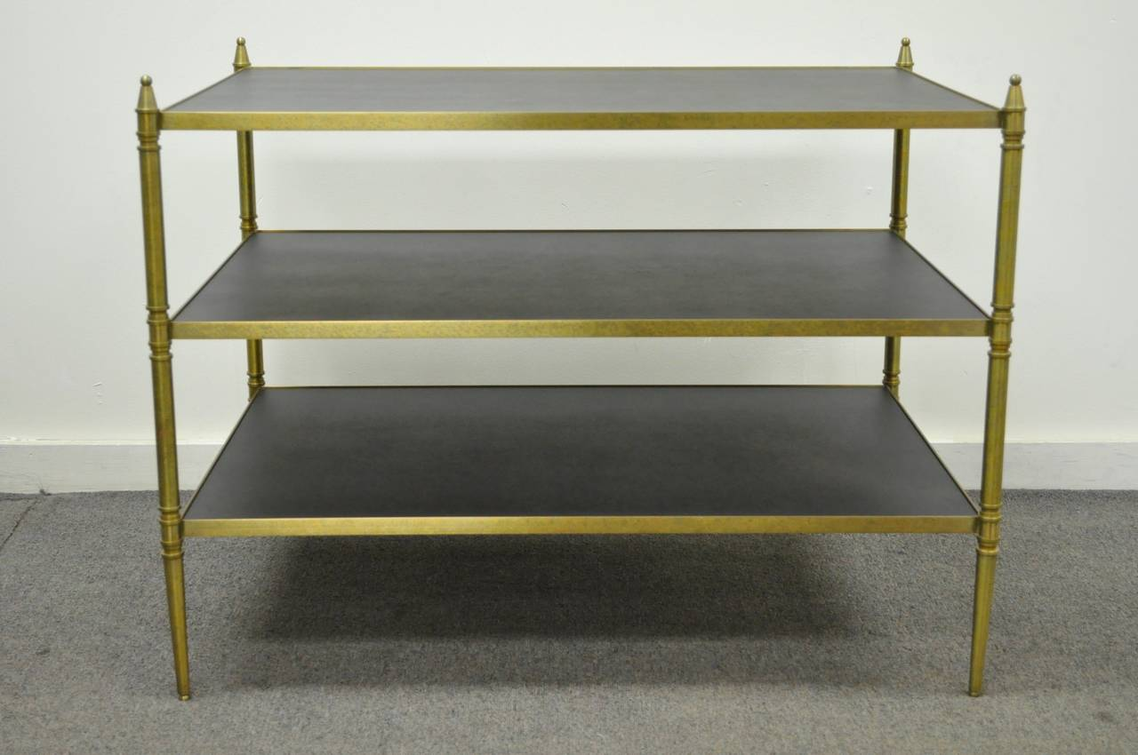 High Quality, Vintage, 3 Tier Bronze and Black Masonite Serving table in the French Neoclassical taste after Maison Jansen. This quality constructed item features clean lines, tapered legs, bronze or brass frame, and very elegant form. Manufacturer
