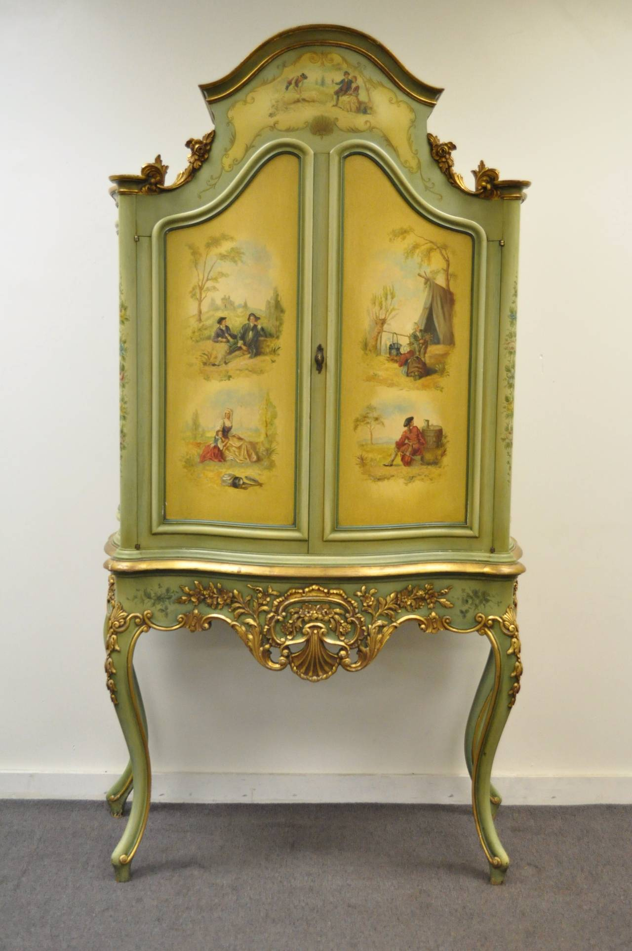 An Exquisitely Hand Carved And Painted French Curio Cabinet In The Louis Xv Taste