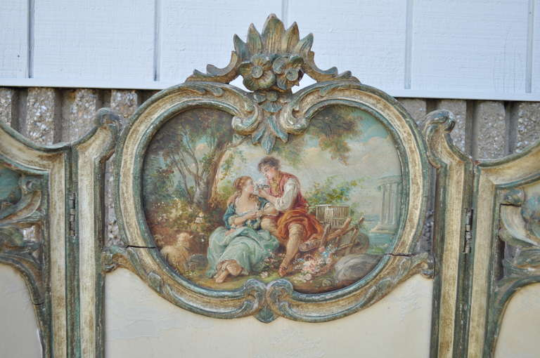 Beautiful and Rare 19th Century Petite Hand Painted and Hand Carved 3 Section Dressing Screen in the Louis XV taste featuring very well done hand painted scenes on the shell carved crest as well as carved cabriole legs, and upholstered sections.