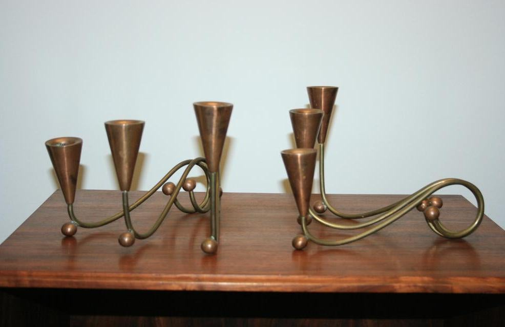 Great pair of vintage American artisan crafted copper and brass candleholders having whimsical form. This Mid-Century Modern / Modernist pair of candelabra features curvaceous brass forms with copper ball accents and three fluted candle holders