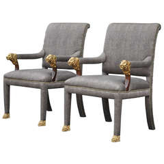 Pair of Bronze Lion Head and Hairy Paw-Foot Library Armchairs, Regency Style