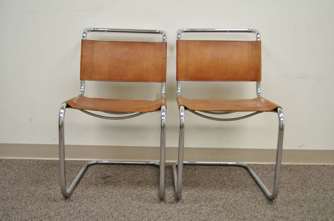 pair of mr brown leather and chrome chairs attributed to mies van