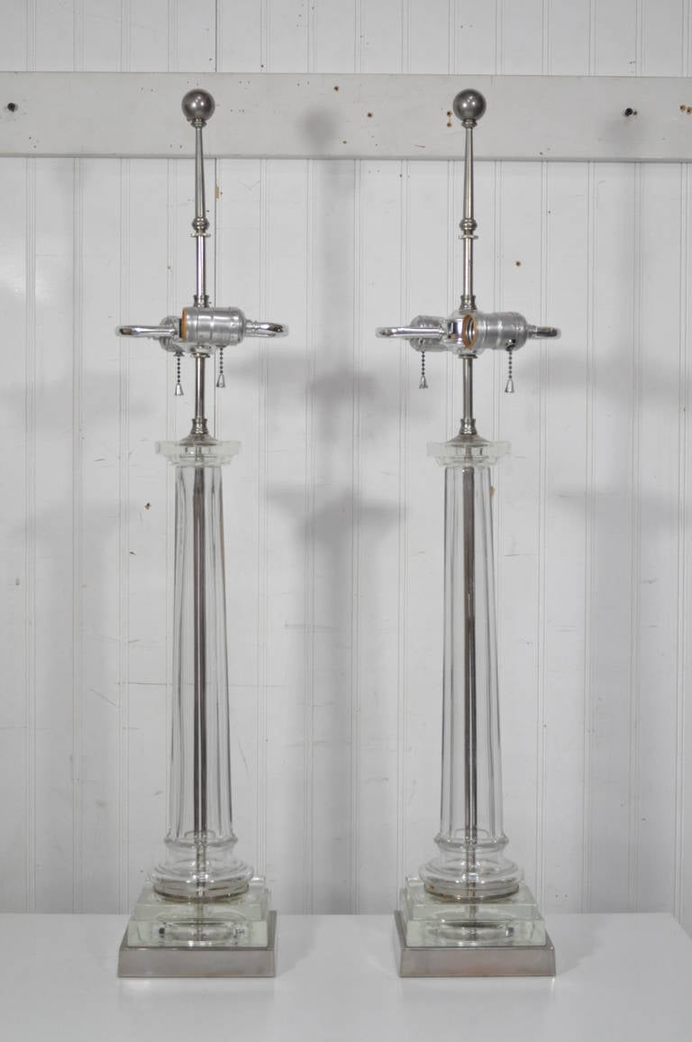 Elegant pair of glass and nickel, eight sided column form table lamps with double light sockets, ball form finials, and great glass column shafts. Very stylish pair of lamps.