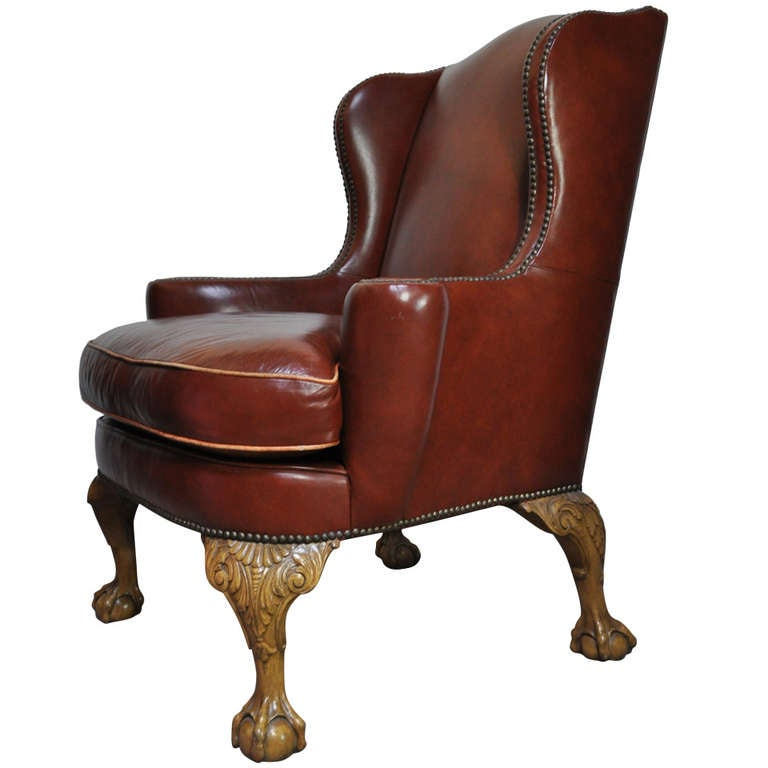 Superior 20th c brown leather ball and claw foot wing back library