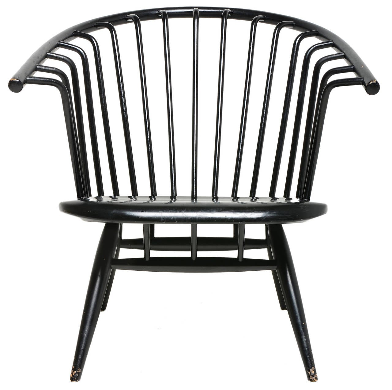 An exceptional iconic chair designed by Finnish Master Ilmari Tapiovaara. A rare example of Scandinavian design. Less than 5000 of these chairs were ever created. Winner of the American Institute of Design award in 1963.
