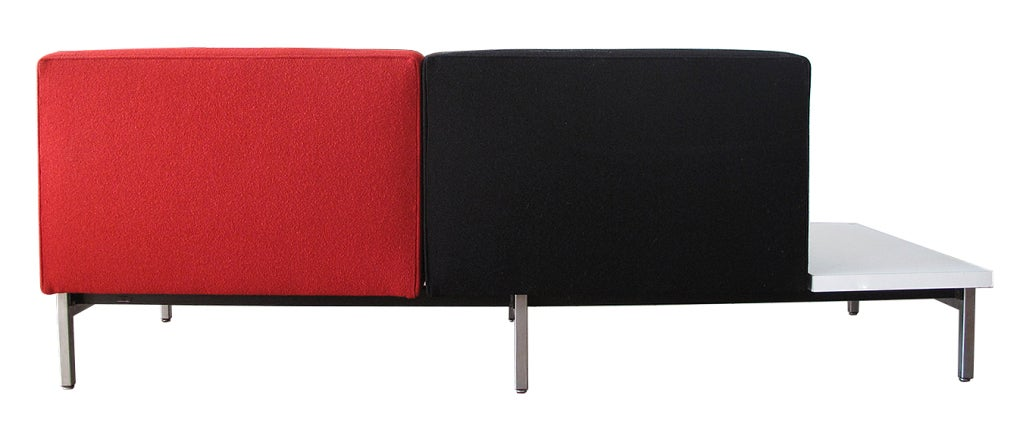 An early and unique George Nelson Settee in original custom upholstery. A part of the modular seating series. An unusual configuration and colour way.