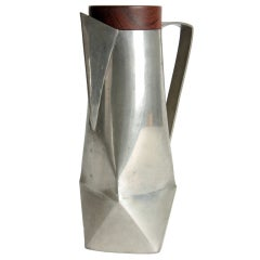 An unusual modernist water pitcher in pewter