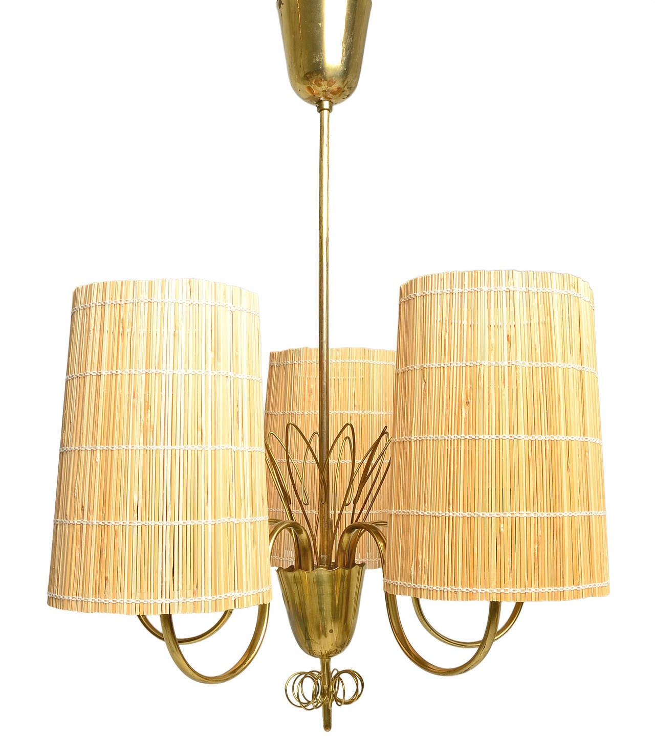 A sophisticated five-arm chandelier in solid brass by Scandinavian master Paavo Tynell.