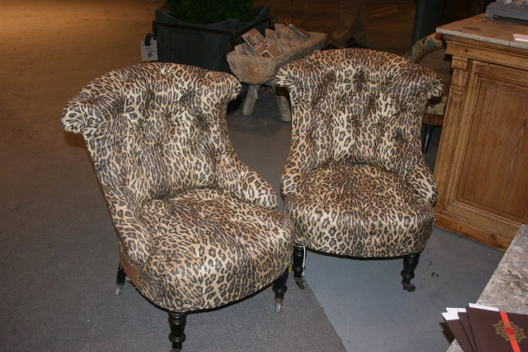 Unique pair of Napoleon III Tufted Salon Chairs. Newly upholstered in Ralph Lauren Kano Linen/silk fabric. Backs left deconstructed to show architecture and age. Turned legs on casters.