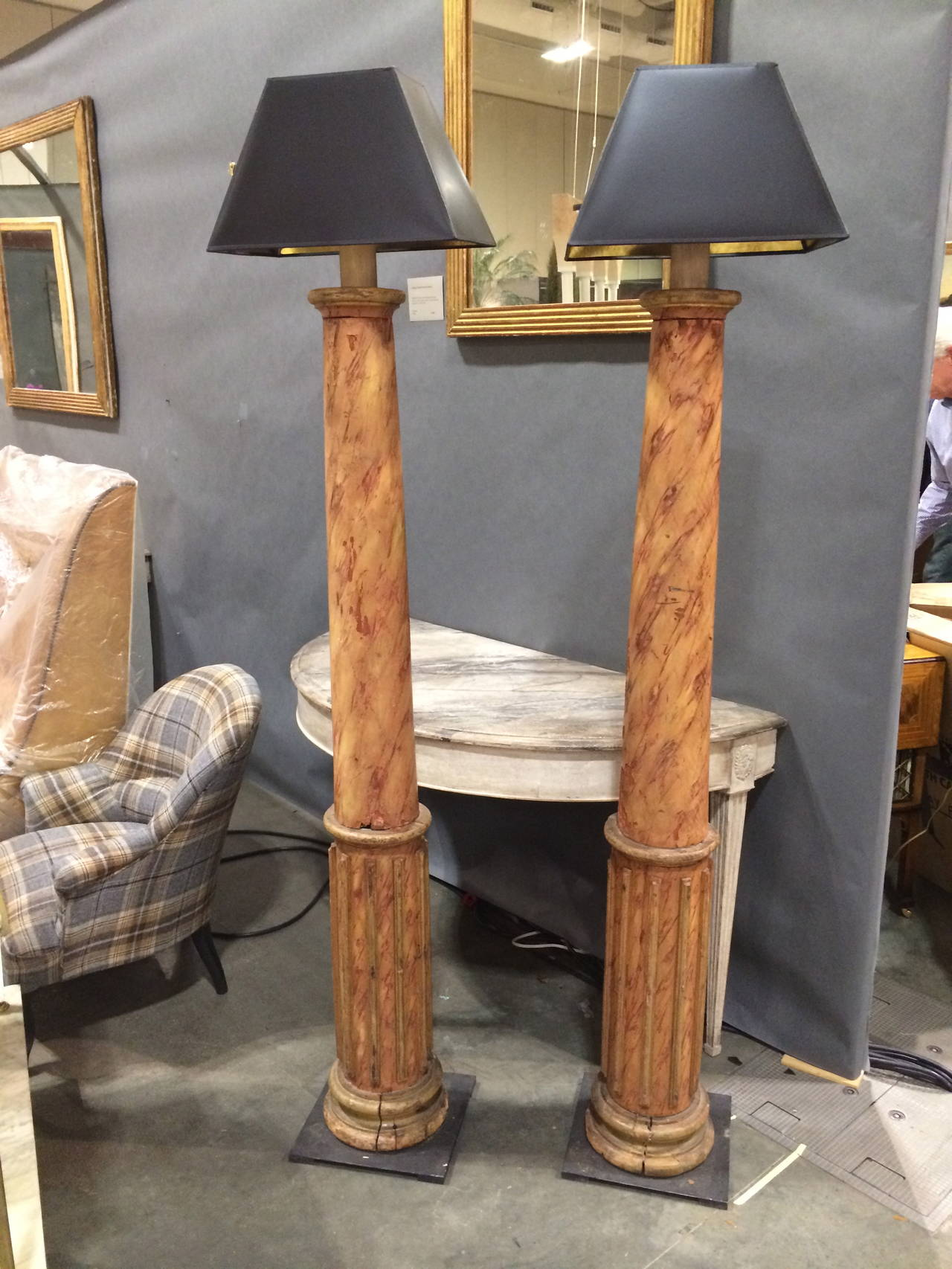 "Pair of 19th C French Faux Marble columns fashioned into lamps with a heavy  metal iron base.  Lamps have been recently wired for the US. Column base is 63"" in height. Fitting and shade bring height to 76"" Shade is not included"
