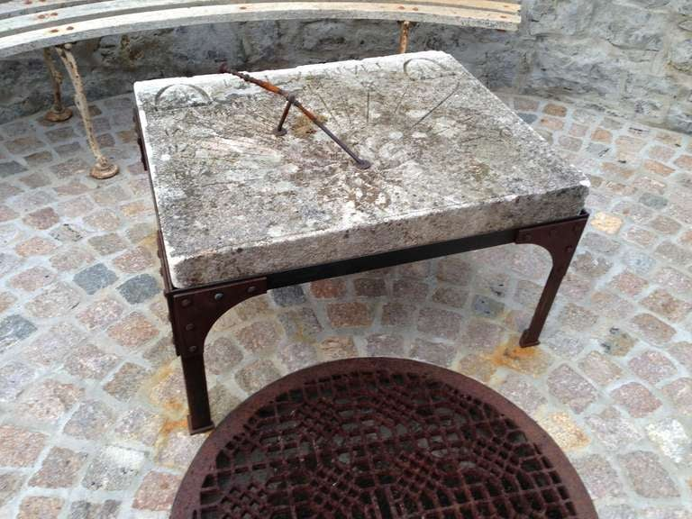 Unusual carved stone sundial found in the south of France. Gnomon has been repaired. Rolled steel and iron stand construction references Eiffel tower and rust has been cleaned and iron sealed. The Latin phrase MANTA PEI is carved at the bottom and