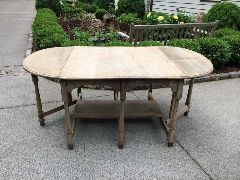 "Elegant French bleached oak drop leaf gate leg dining table. Beautiful patina. 71""l x 41""w x 31.5""h open. Top is 41"" x 41"" closed. There is 28"" of leg room under the apron."