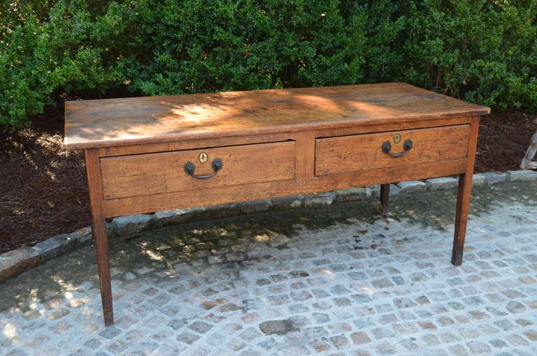 Rich patina on this 1830 Sycamore regency server with original pulls and dovetail pine drawers. Two elegant long drawers and tapered legs