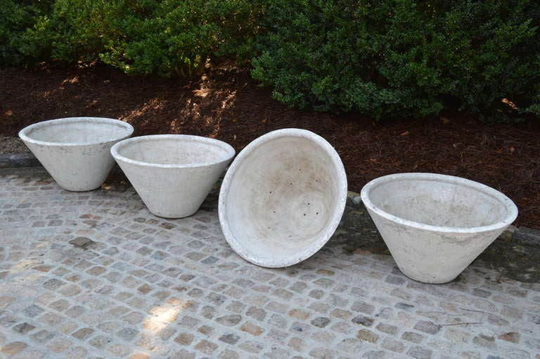 Set of Four Large Antique French Concrete Planters. Each has a beautiful weathered chalk finish and drain holes. From Isle Sur La Sorgue. Priced separately. One is sold and three are available