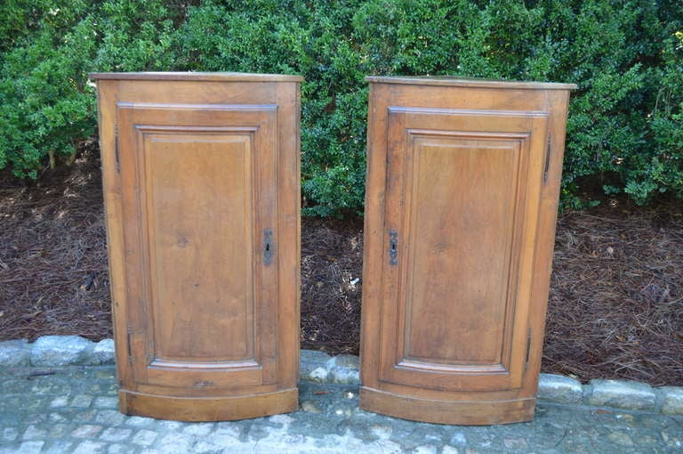 Pair of Hanging French Walnut Corner Cabinets. Original Brass hinges and two interior shelves. Priced separately.