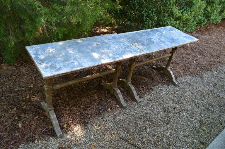 Pair of French zinc and wood bistro tables. Can be used together for one long table. Priced separately. only one is available and one is sold