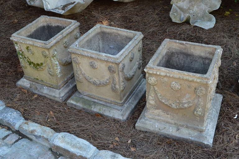 3 19th c. English Compton Stone Planters from Petworth. Finely detailed saw rose carvings. Each sits on a removable base.