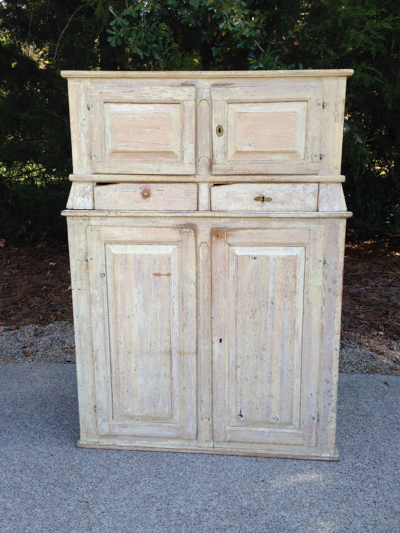 Lovely patinated Swedish Cabinet with two upper drawers. Top detaches from Bottom Cabinet for easier transport.