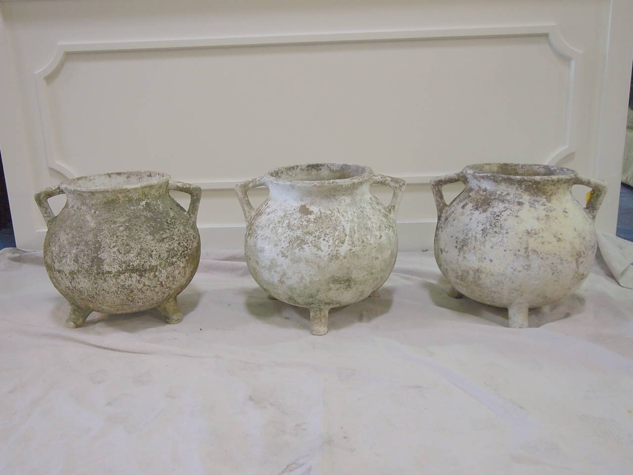 Set of 5 Large round French footed planter pots with beautiful chalk patinas. Priced separately.