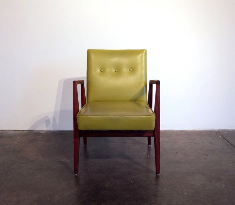 Jens Risom chair in walnut with original lime green Naugahyde upholstery.    