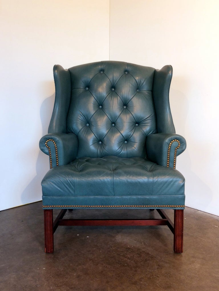 Tufted Leather Wingback Chair And Ottoman By Hancock And