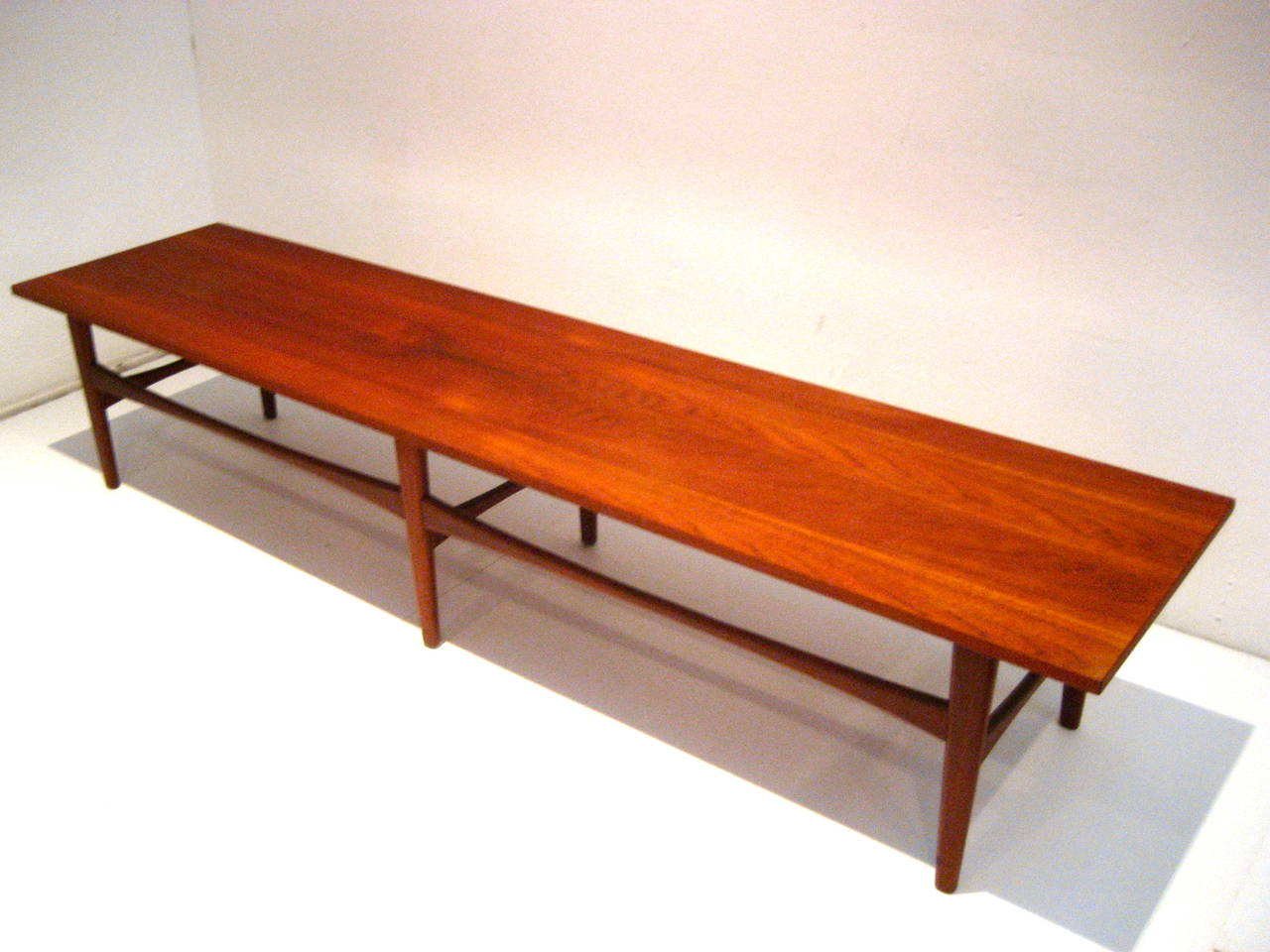 Danish modern long coffee table or bench in teak at 1stdibs for Cocktail table with 4 benches