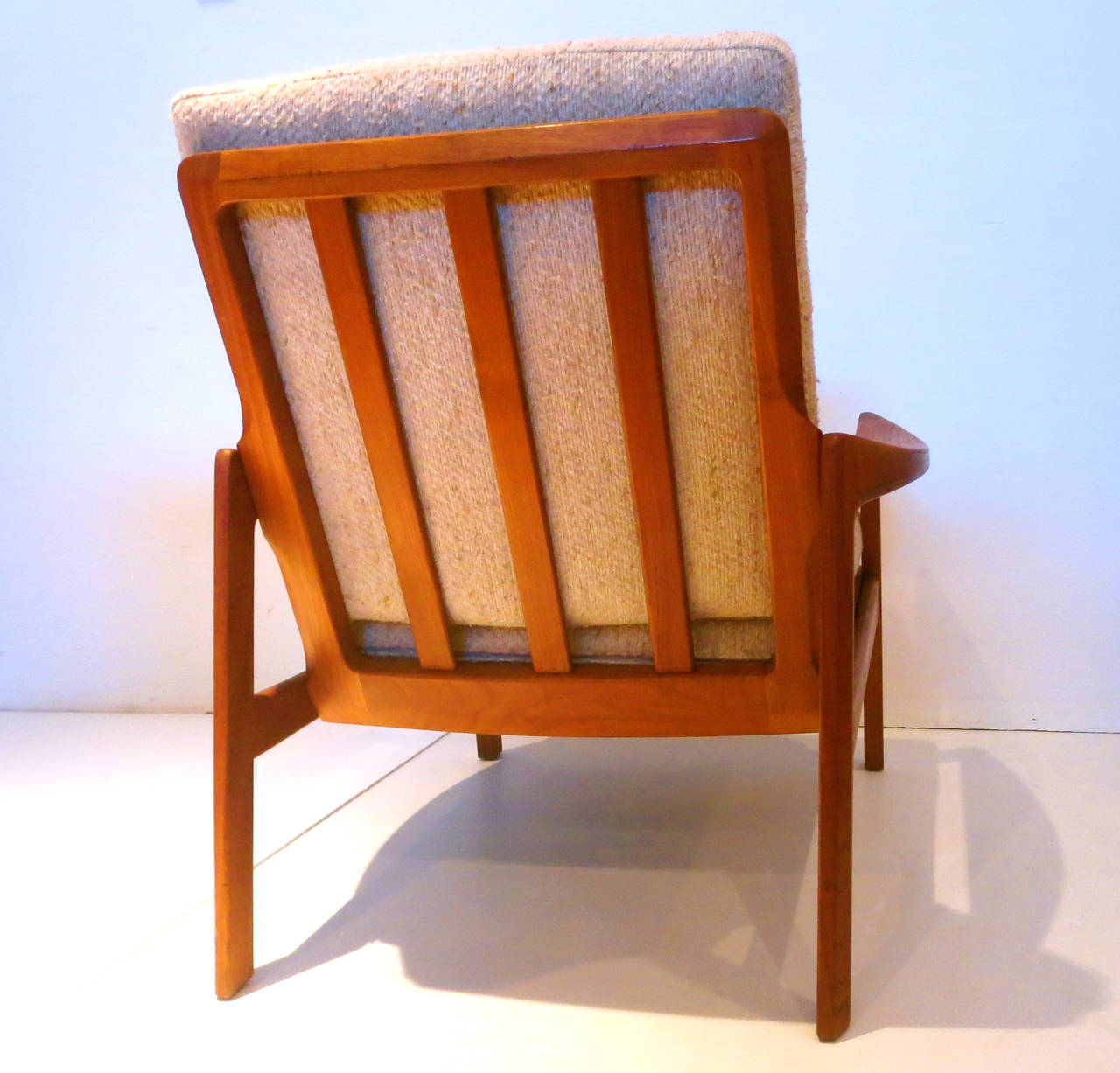 this nice solid dark teak danish modern lounge sculpted armchair is no