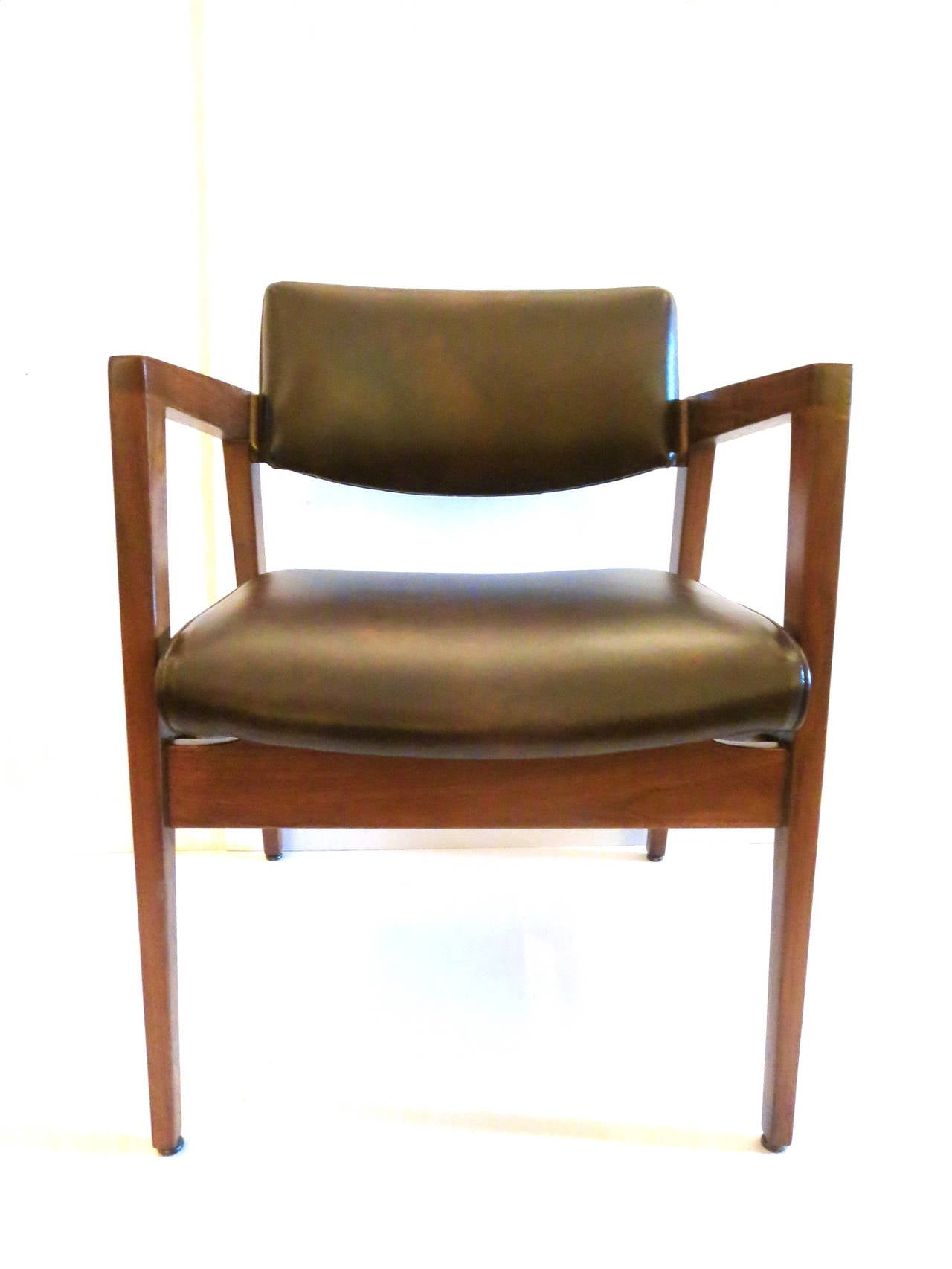 1950s american modern walnut and leather armchairs by American classic furniture company