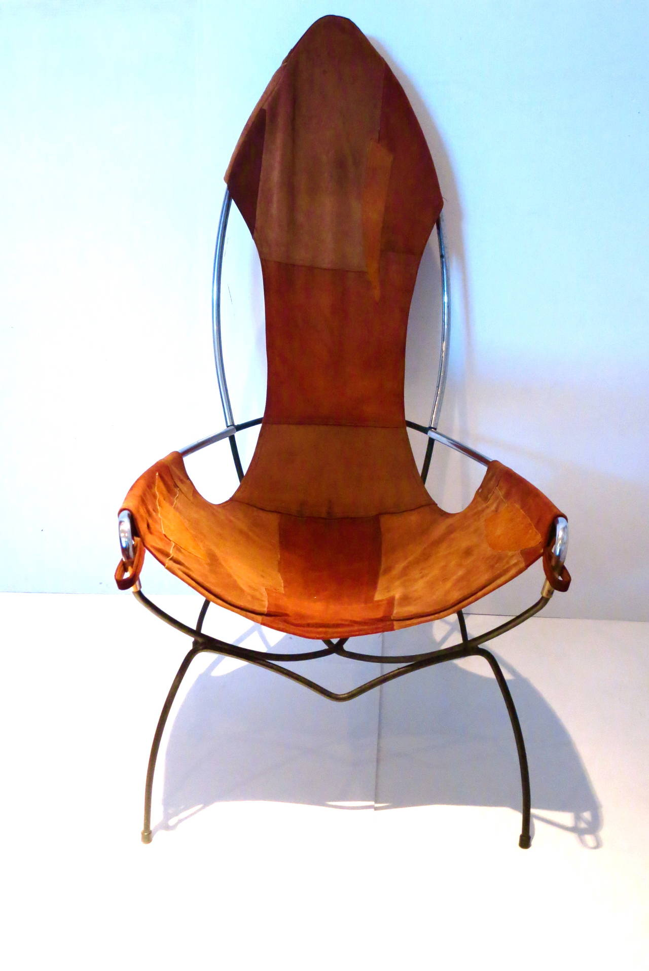 A rare tall back sling chair in leather iron and chrome atrib to