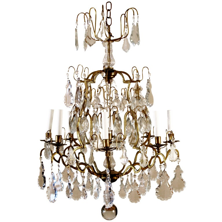 French vintage crystal and brass eight light chandelier at