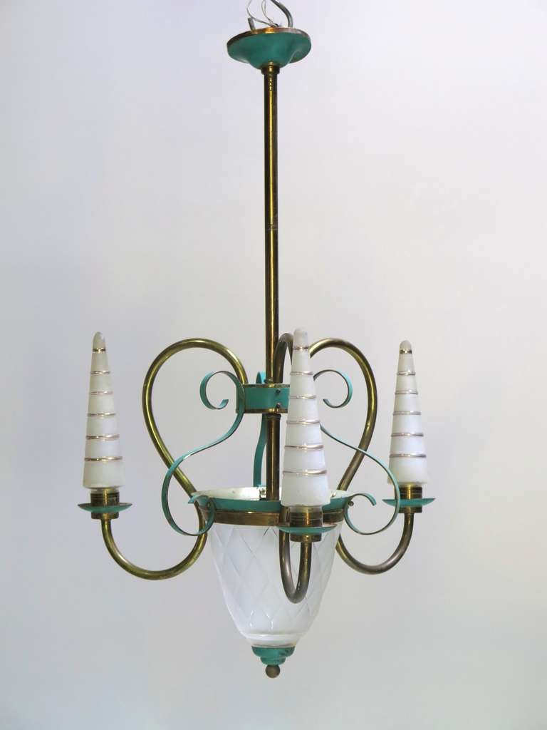 Elegant chandelier with three brass arms and central stem, green-painted tole, and frosted glass lights.