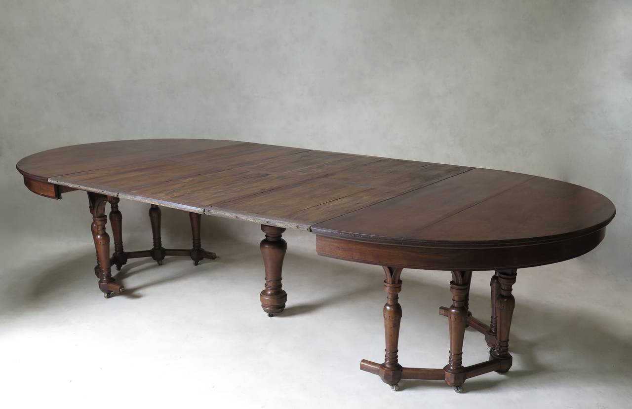 Oval extending walnut dining table france 19th century for Oval dining table