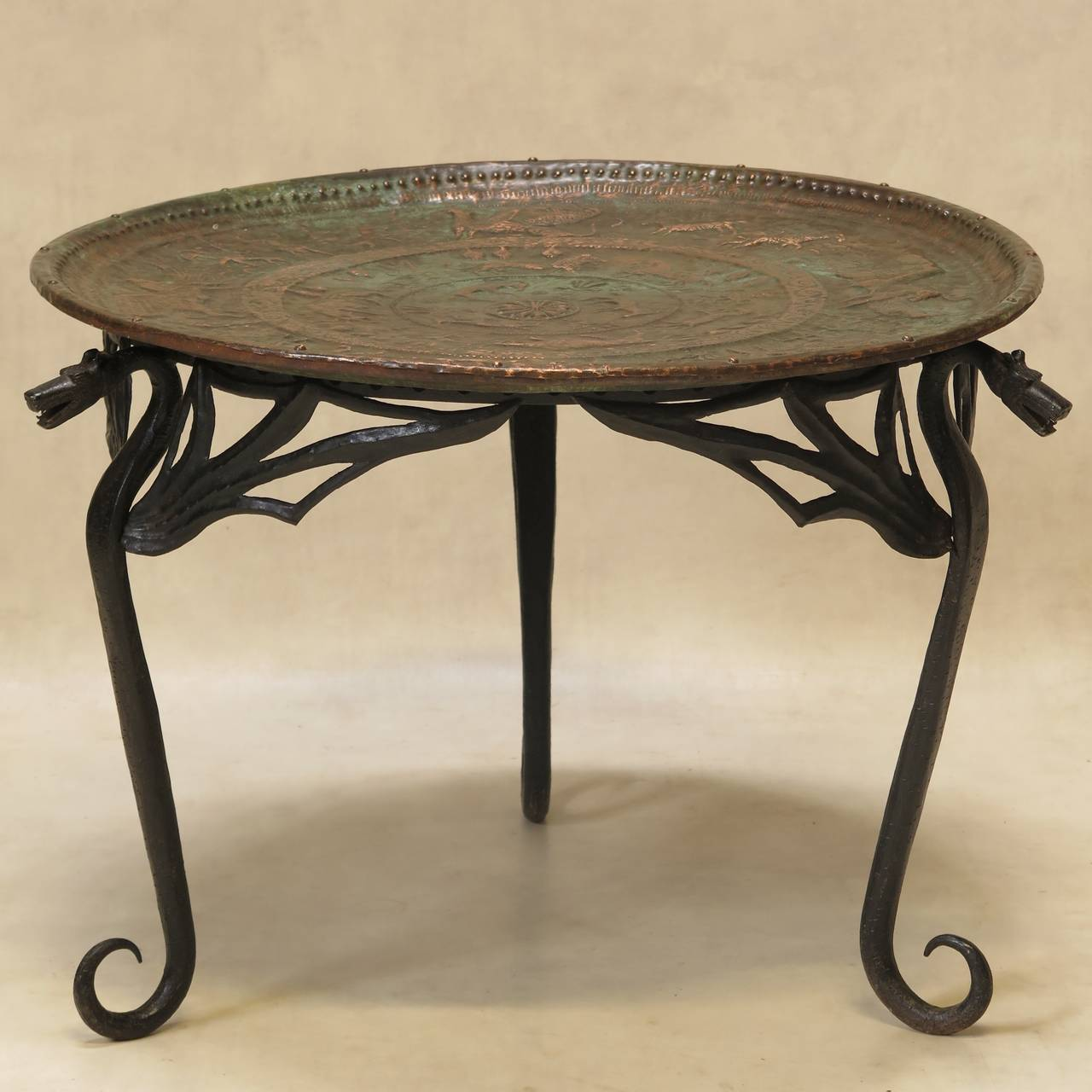 Unusual Round Coffee Or Side Table With A Wrought Iron Base Decorated Around The