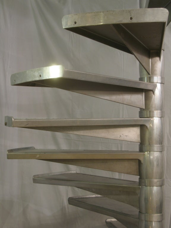 Very rare large staircase made of cast aluminium. Each step is independent and slots onto a central shaft, meaning that the height can be adjusted to suit requirements.  Each step measures (in centimeters):  Length: 73. Width: 40. Height: