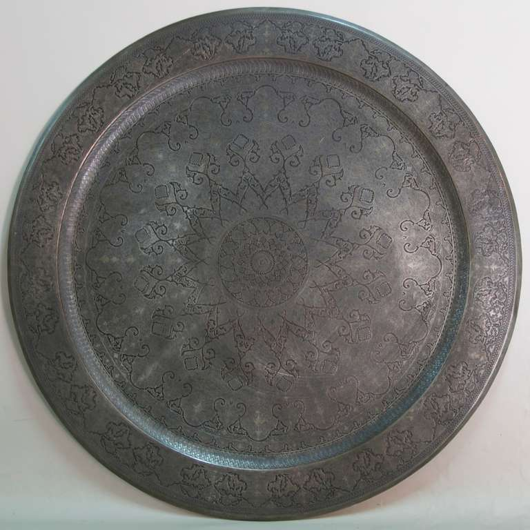 Large and elaborately carved Middle Eastern (Persian?) tinned copper tray. Beautiful craftsmanship. Very heavy.