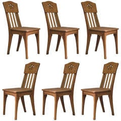 Six Arts & Crafts Style Oak Chairs by Léon Jallot