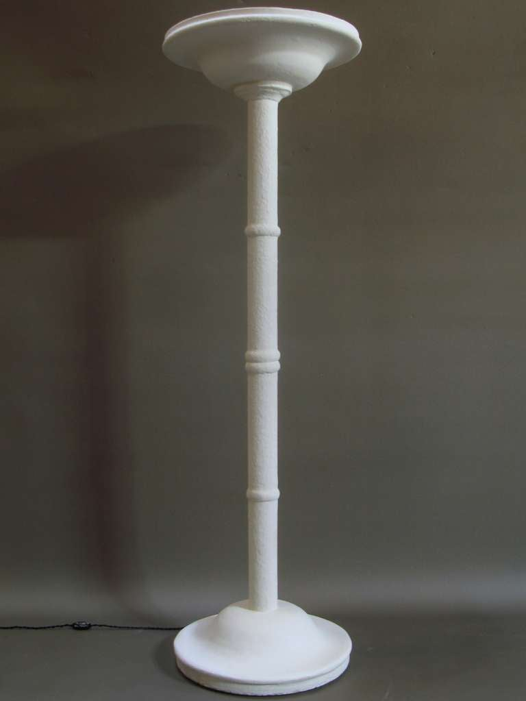 Lovely and heavy floor lamp made of plaster with a textured finish.