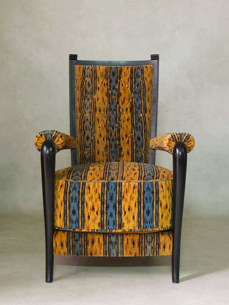 Set of three Art Deco armchairs in the style of Maison Dominique, with glossy black structures, upholstered in vintage blue and yellow velvet fabric.  Button tufted backs. Very large seat cushions.